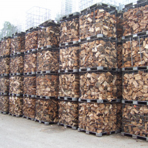 Firewood drying in cages
